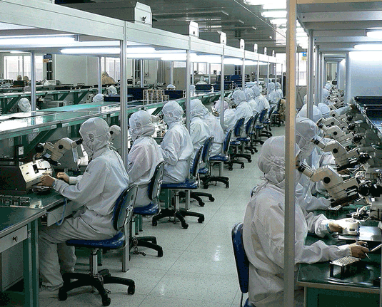 Chinese high-tech assembly line workers. Image courtesy jurvetson via flickr.